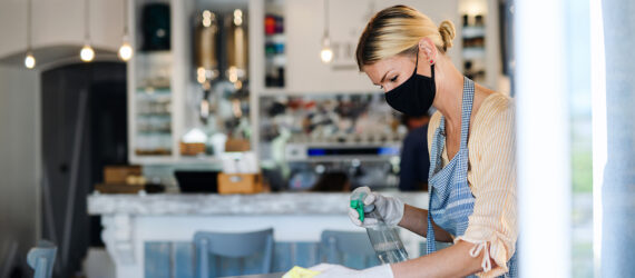 Woman cleaning surface, Office sanitation services in New Jersey