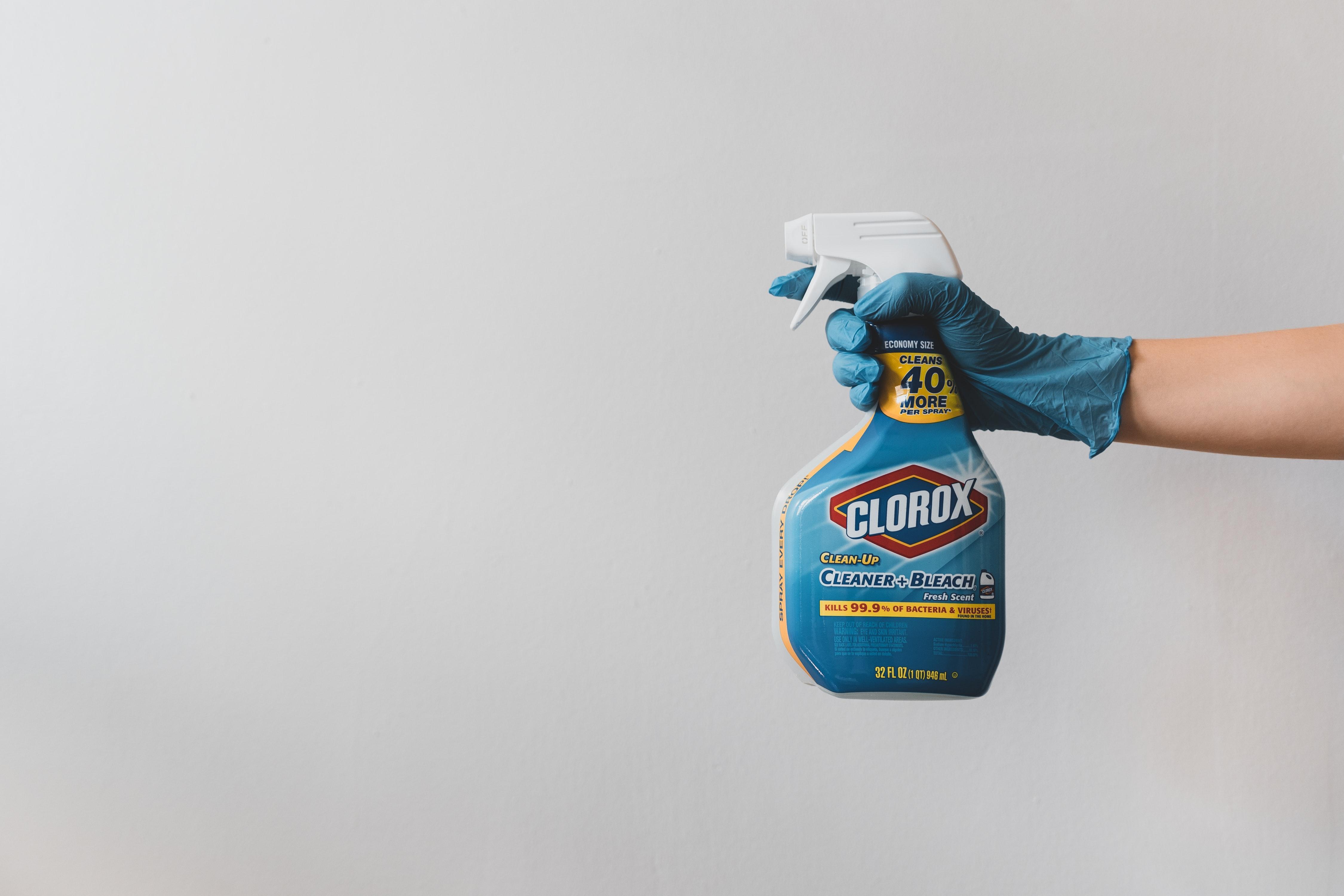 hand-holding-bleach-sanitation